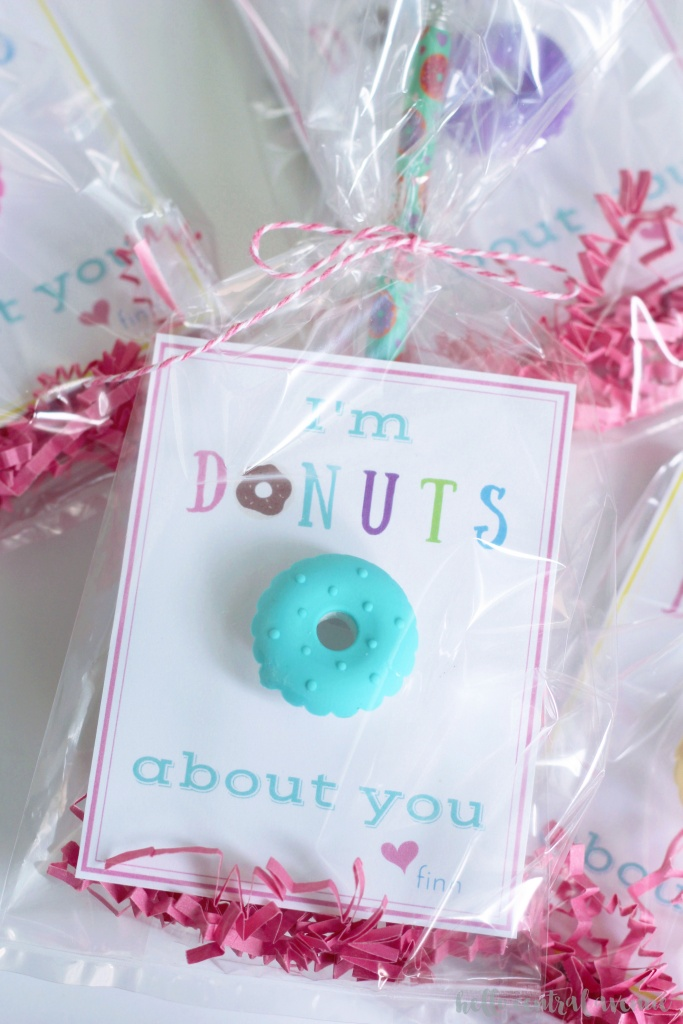 "Free printable ""I'm Donuts About You"" valentines. Mini donut erasers and pencils make these valentines super cute."
