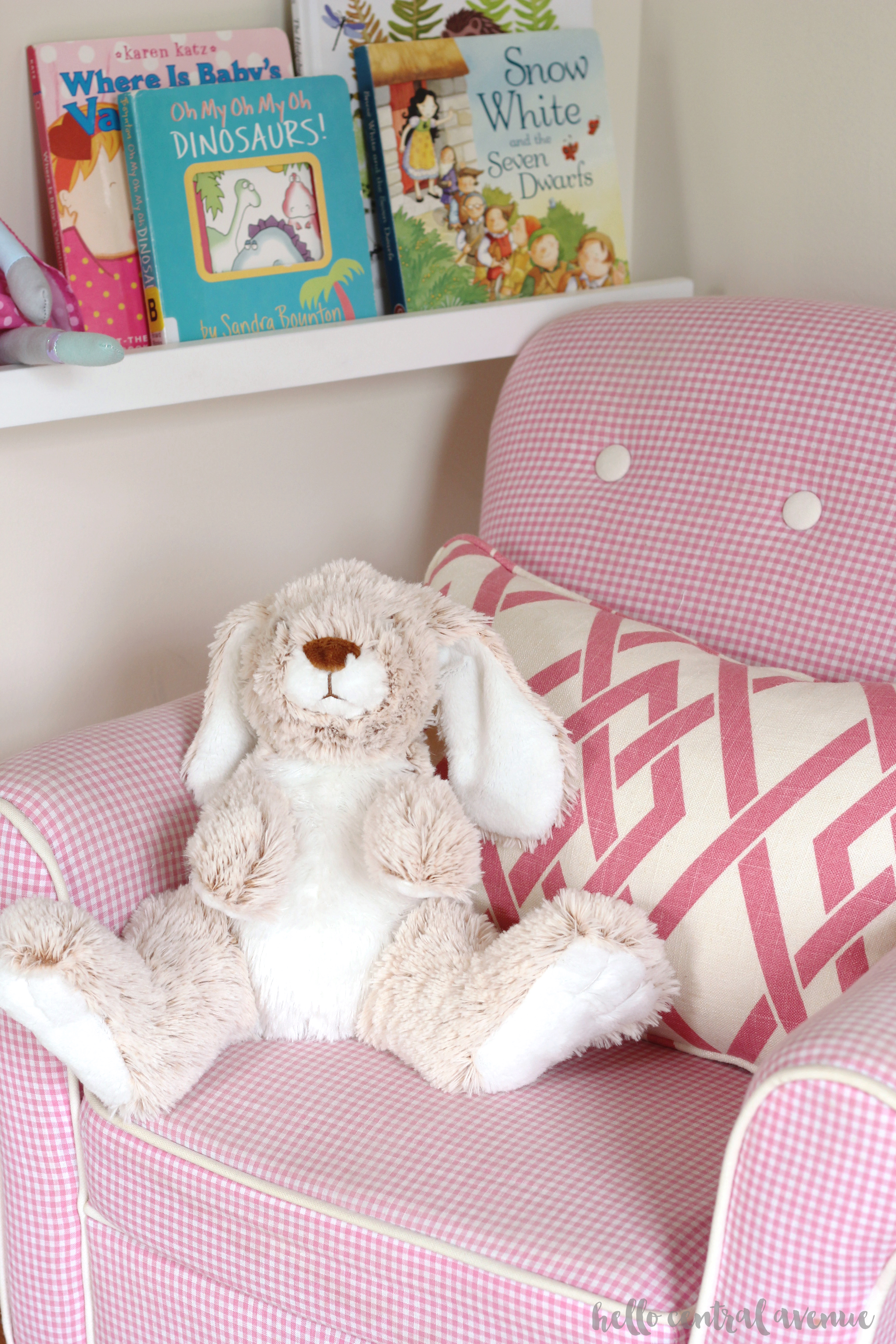 Here is a cozy and pink reading nook using Target picture ledges to display books.