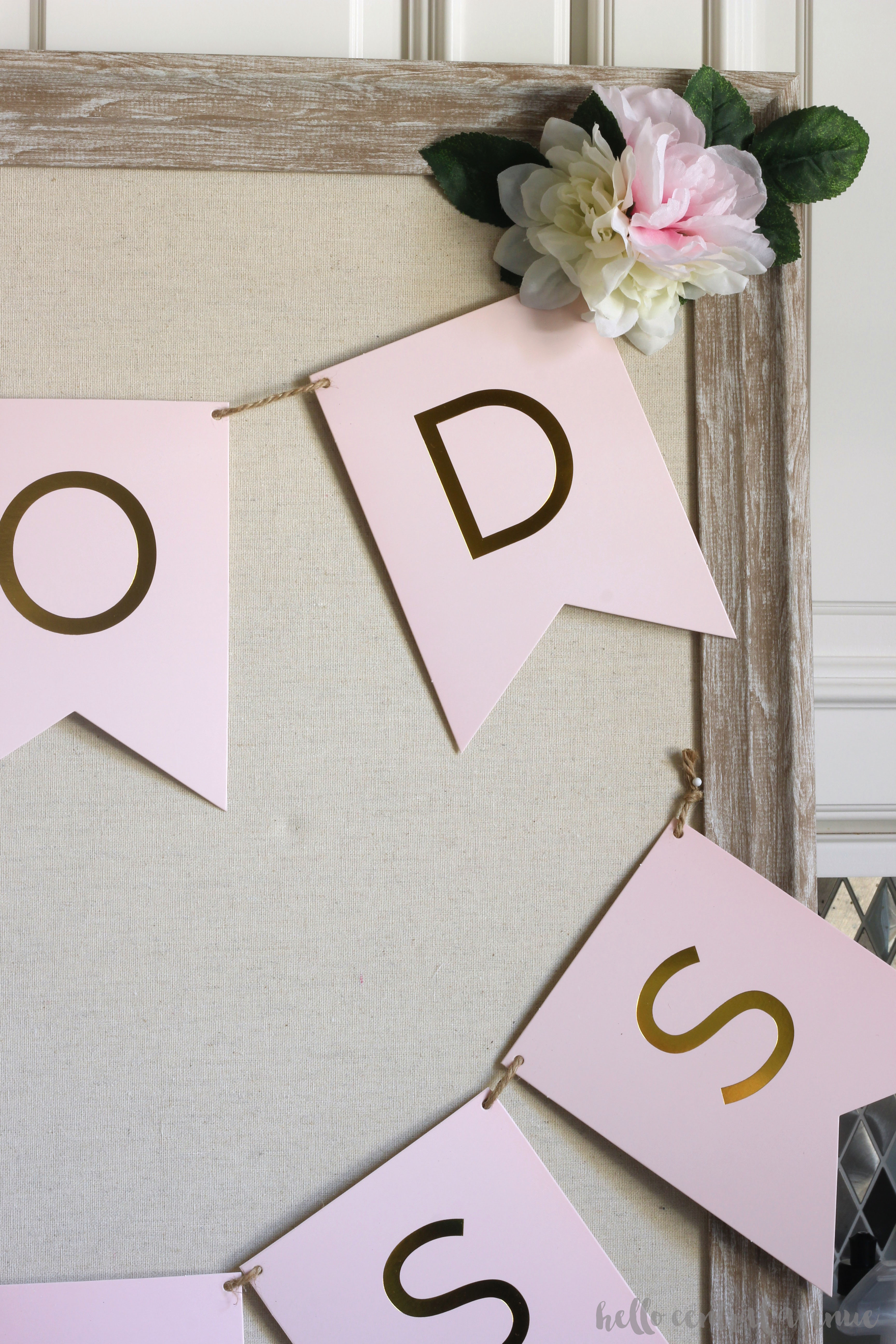 Here is an easy, inexpensive, and beautiful DIY first communion sign. You can easily add some gorgeous decor to your party by bringing in pink and gold to the traditional white. The dollar store flowers add some dimension to this already sweet little piece of party decor.