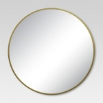 Brass wall mirror from Target to hang above the changing table