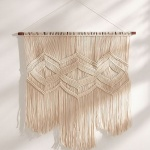 Urban Outfitters macrame wall hanging for above the changing table