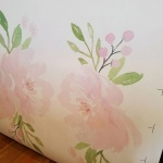 Blush pink floral wall decals to hang above the changing table