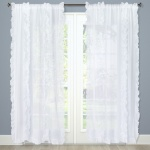 Ruffled curtains to hang above the changing table with a window