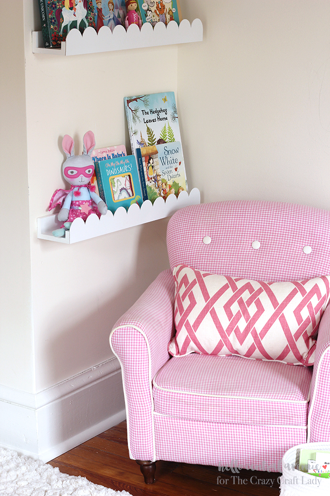 Add scalloped trim to plain book ledges to create a fun and whimsical feeling. The scalloped nursery book ledges add a bit of character to an ordinary item.