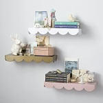 Scalloped wall shelf from Crate and Kids to hang above the changing table