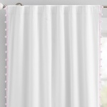 Pottery Barn cotton pom pom curtain for above the changing table