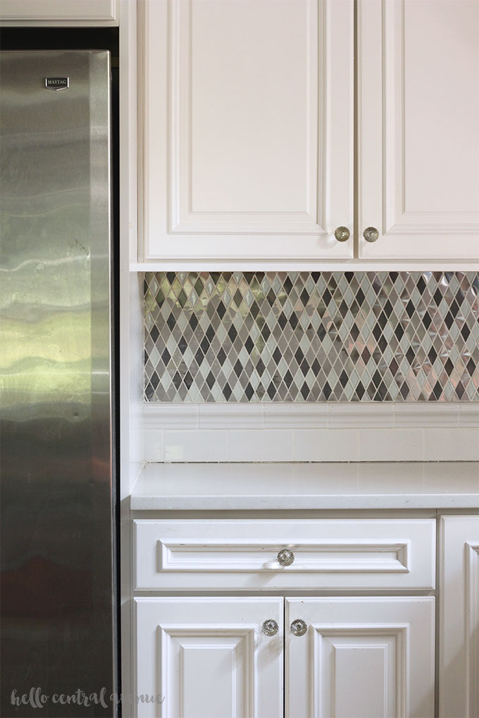 Here is a money saving DIY trick for changing your tile backsplash!  All you need is some paint and time!  Read on to find out what I used for my painted tile backsplash.  You'll totally be surprised at the transformation!
