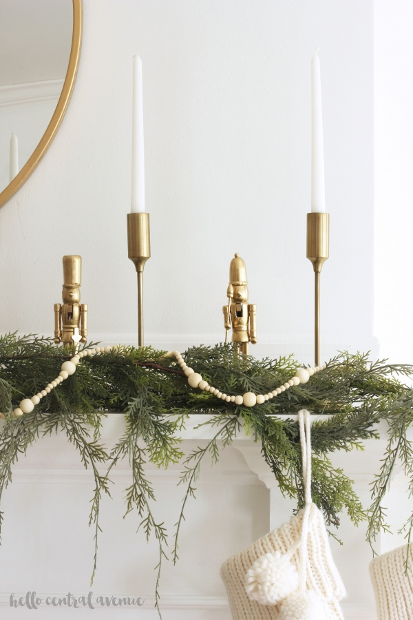 Spray painting your nutcracker decorations is a easy way to update these Christmas pieces! By painting them gold and white, they become more modern and classic, and can fit into any style of decor.