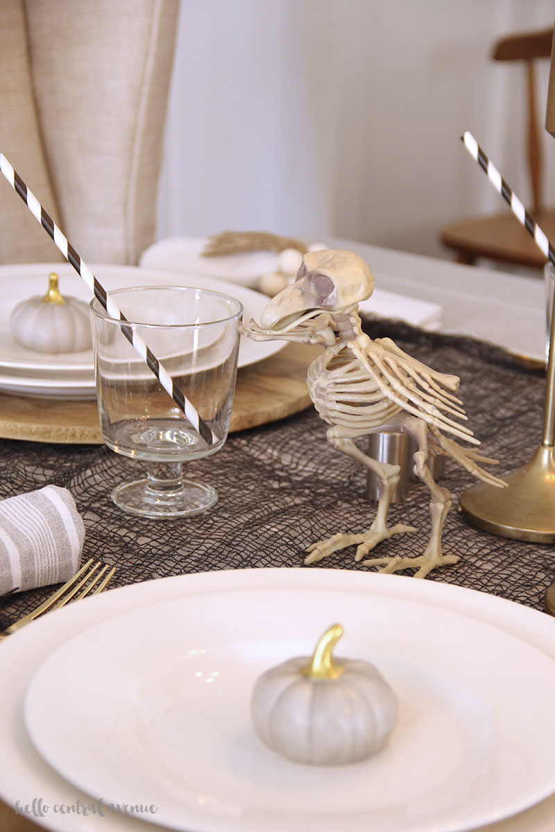 An easy halloween table runner and tablescape filled with cheap spooky decorations.
