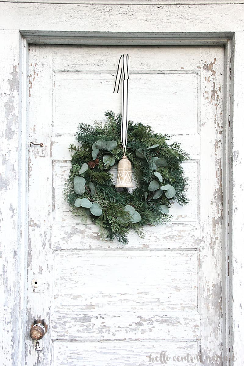 Make this easy DIY faux winter eucalyptus wreath to last all winter long, even after the holidays!