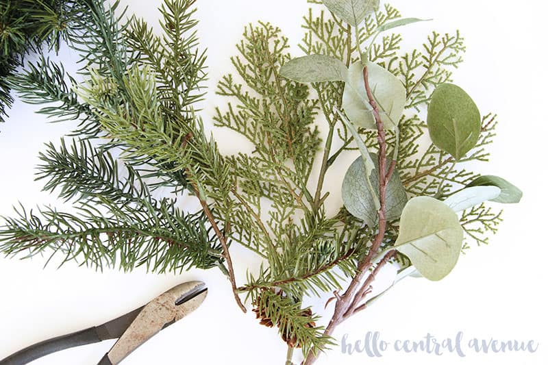 Materials for the easy DIY faux winter eucalyptus wreath.