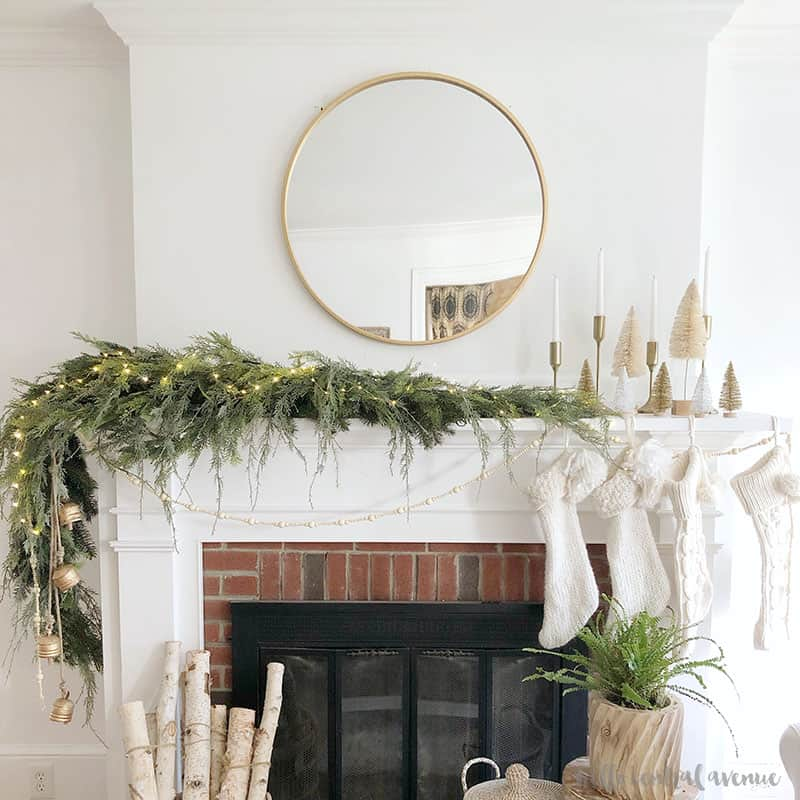 If you are looking to update your Christmas mantel decor, try using this asymmetrical Christmas garland idea to modernize your holiday decorating!
