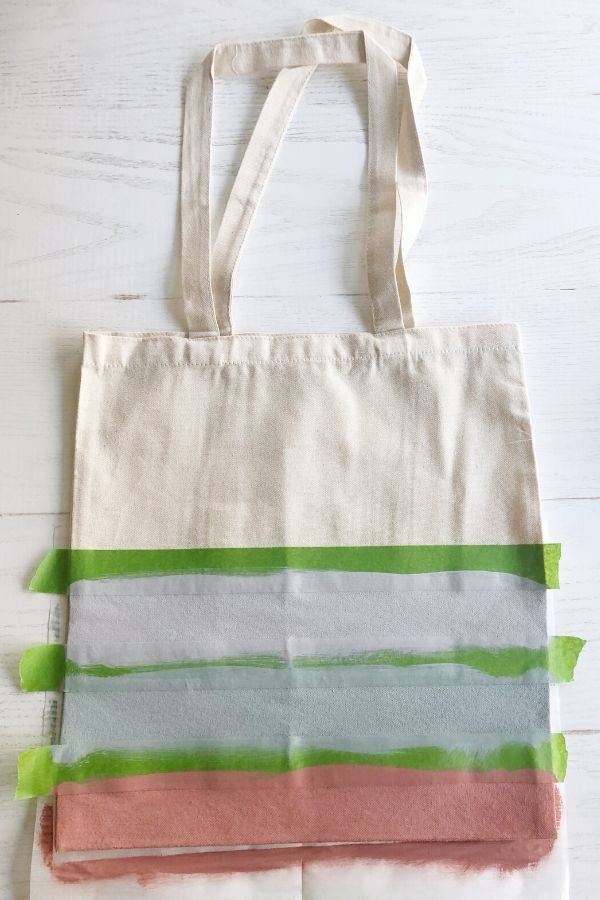 Simple and easy DIY painted canvas tote bags for spring. Step 2, paint tote bag.