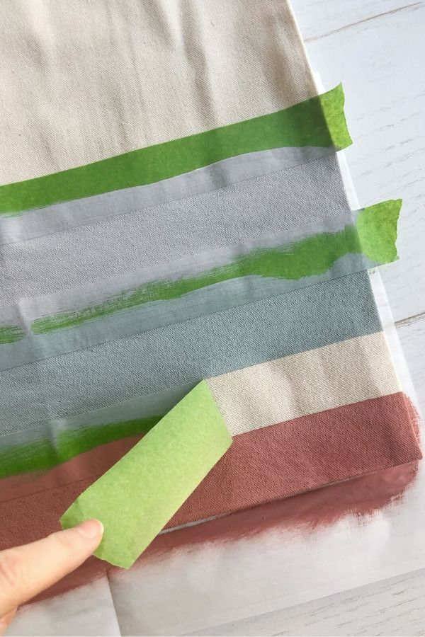 Simple and easy DIY painted canvas tote bags for spring. Step 3, peel off paint while still dry.