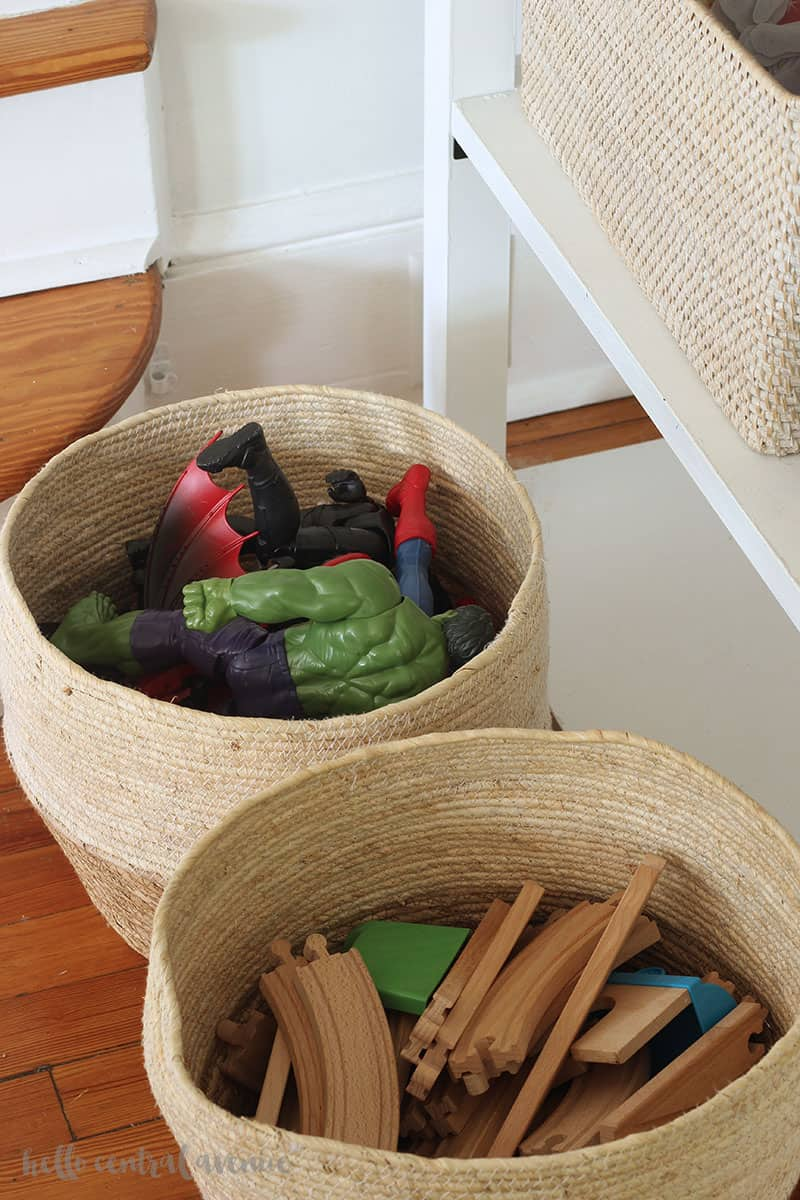 These living room toy storage organization ideas are not only functional, but they are pretty too! Now you can keep toys hidden and the living room clean!