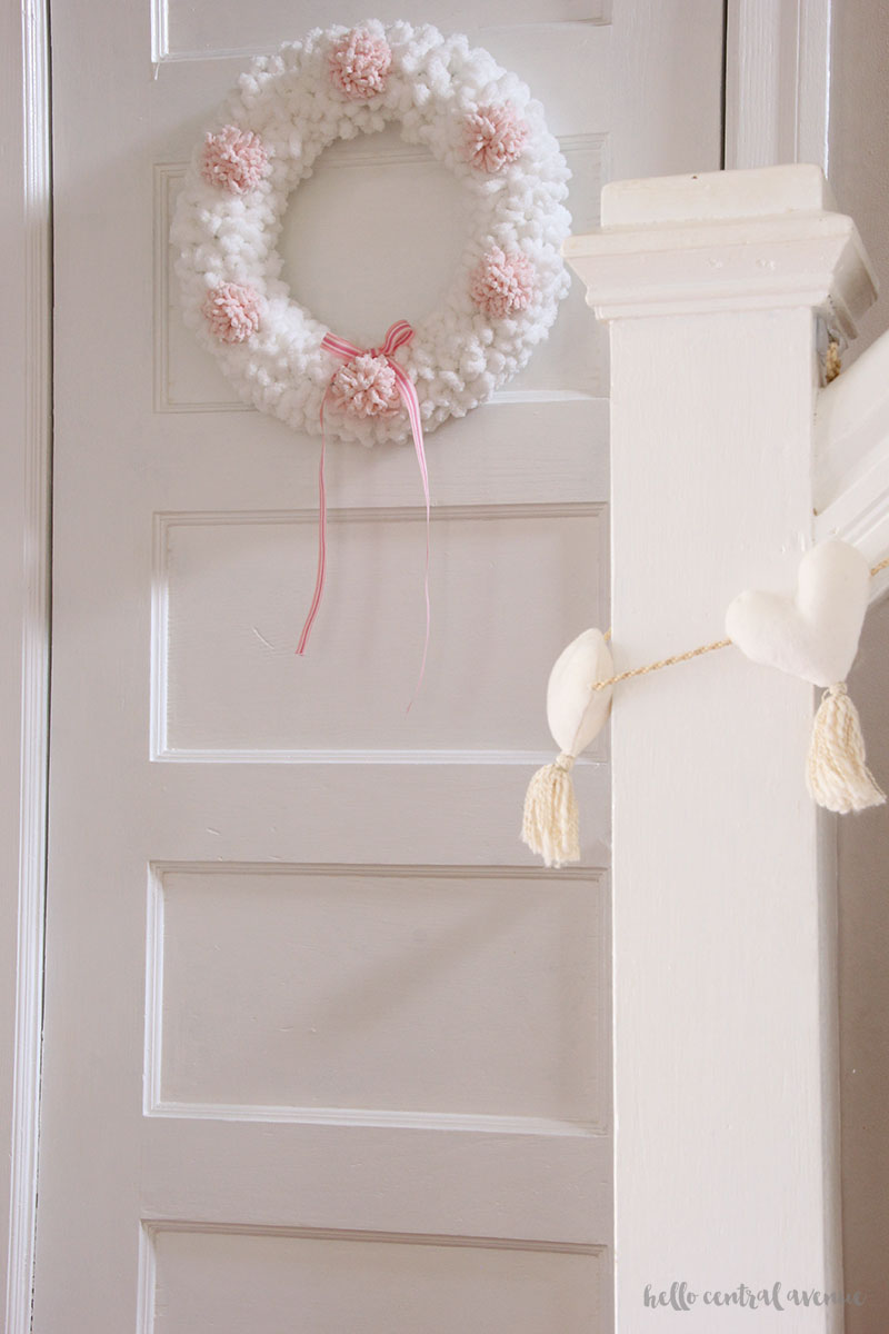 How to make an easy yarn and pom pom wreath for Valentine's Day to hang on your door.