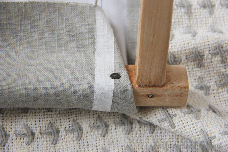 Tacked on fabric for diy upcycled folding stools.