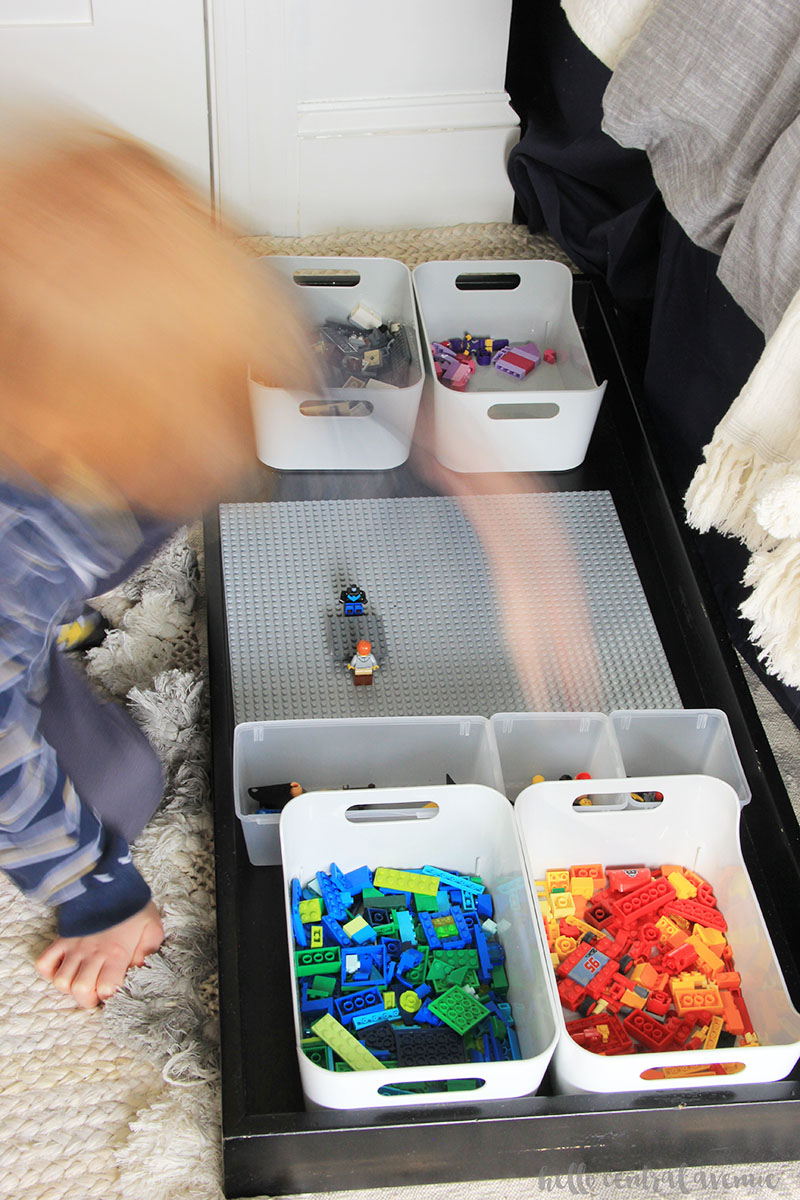 Under the bed Lego storage using a dresser topper changing table.